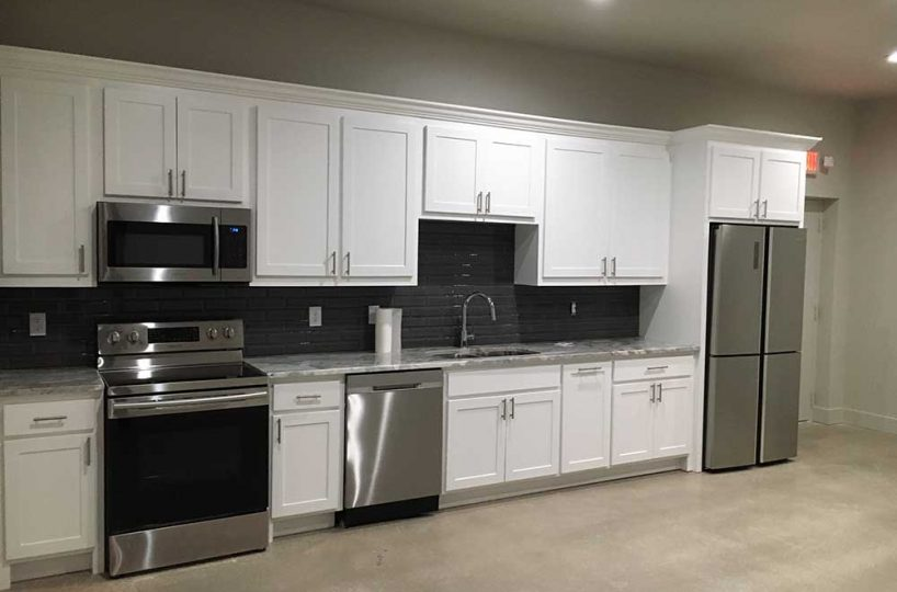 Large kitchen inside industrial property for lease in Newark.